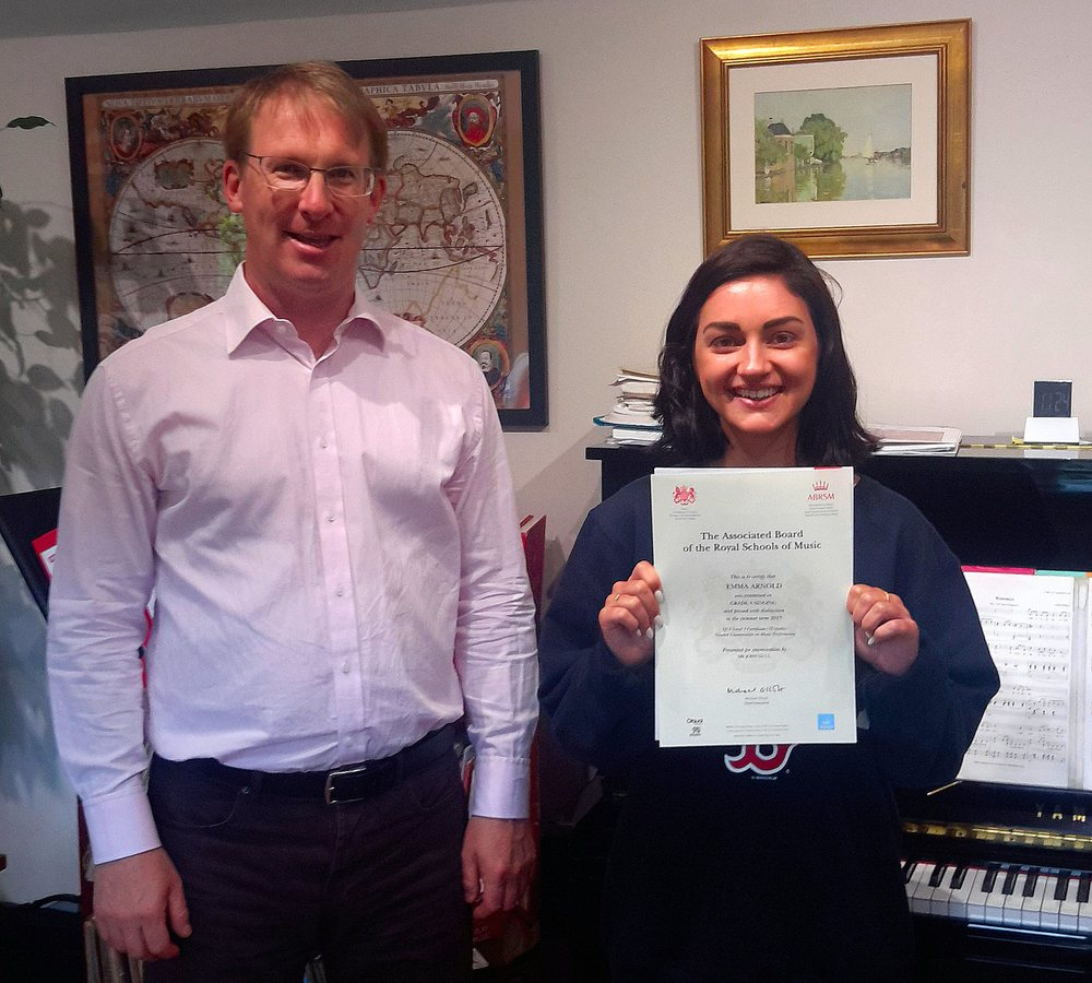 John with Emma Arnold following her distinction at Grade 8 Singing