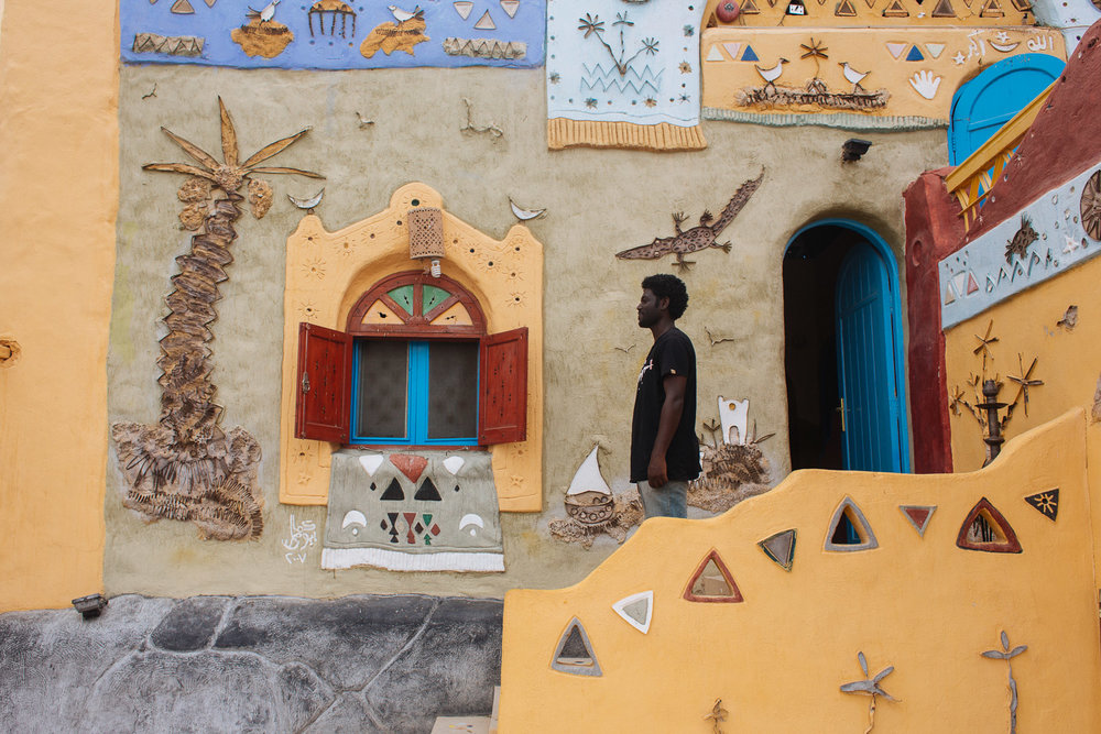 Mohammed poses outside one of the Nubian houses. The wall art was so fresh and colourful.
