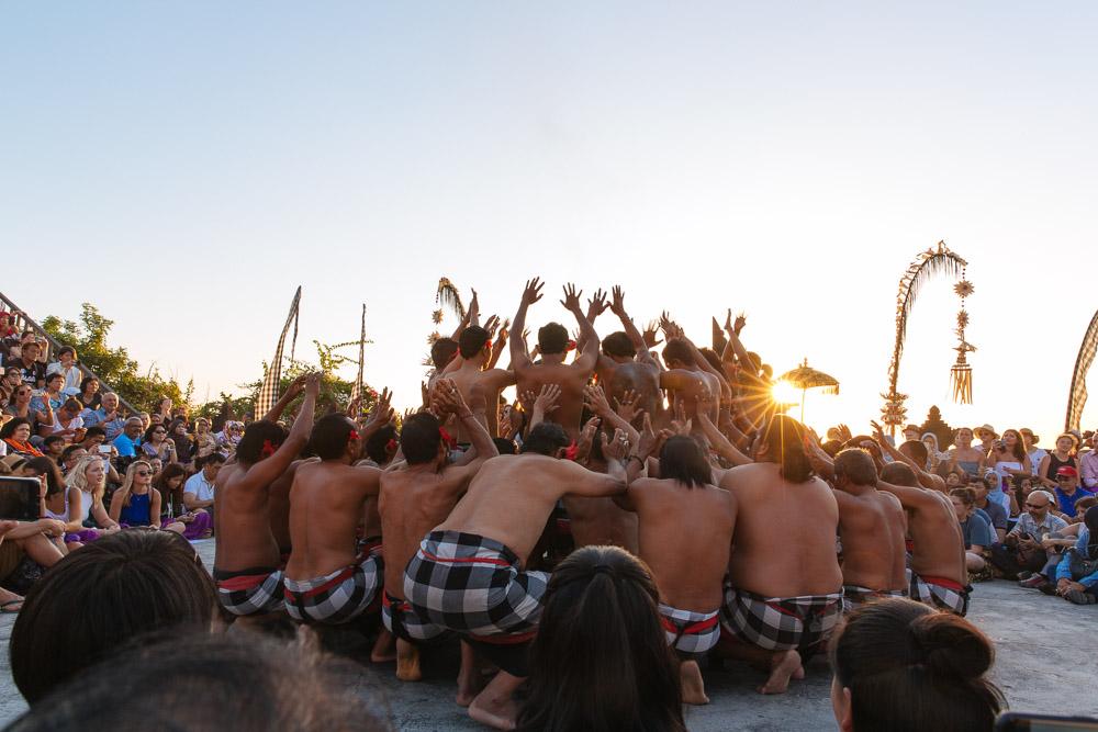 Kecak dance in motion at sunset.