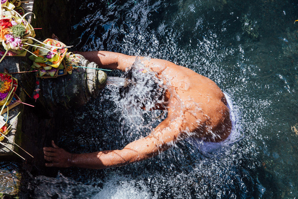 A man lets the water from the springs wash over him.