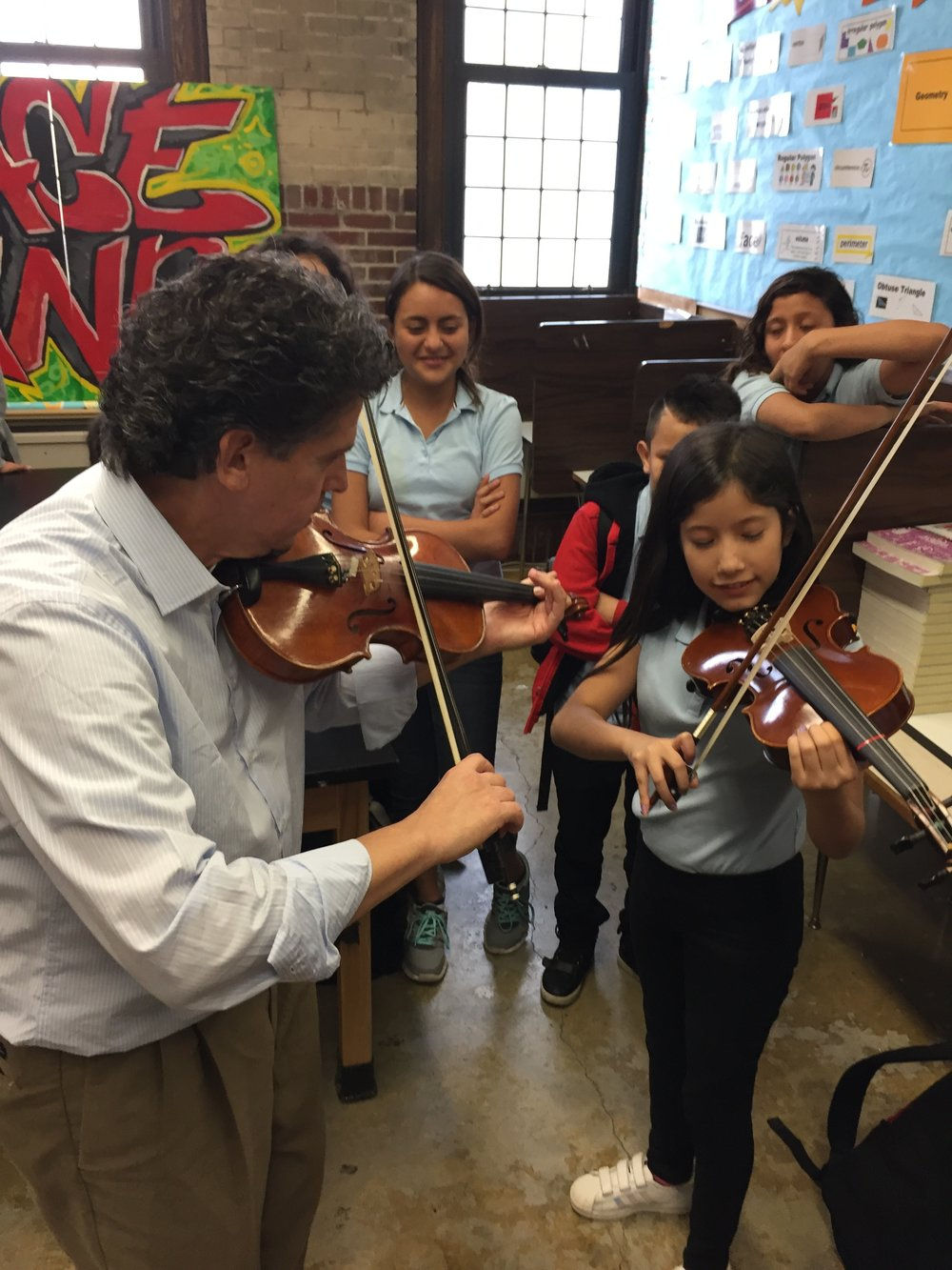 STRING SECTION: Students at Grace A. Dunn Middle School in Trenton are learning the violin from José Gregorio Sanchez Rodriguez, who is a product of the highly successful El Sistema program in Venezuela. Rodriguez also teaches at Westminster Conservatory in Princeton.