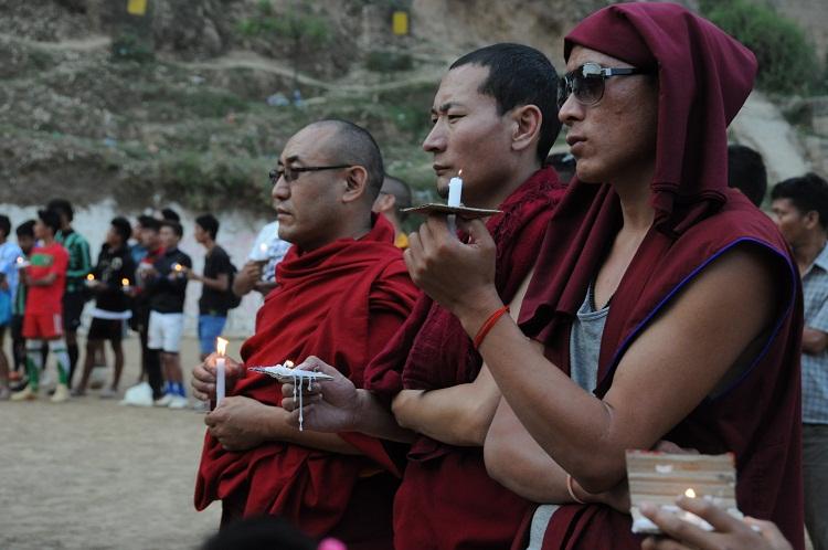 Tibetan monks in Dharamsala mourn for the self-immolators