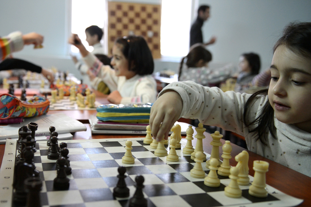 2. Children playing chess at Yeghishe Charents Basic school in Yerevan by Felix Gaedtke
