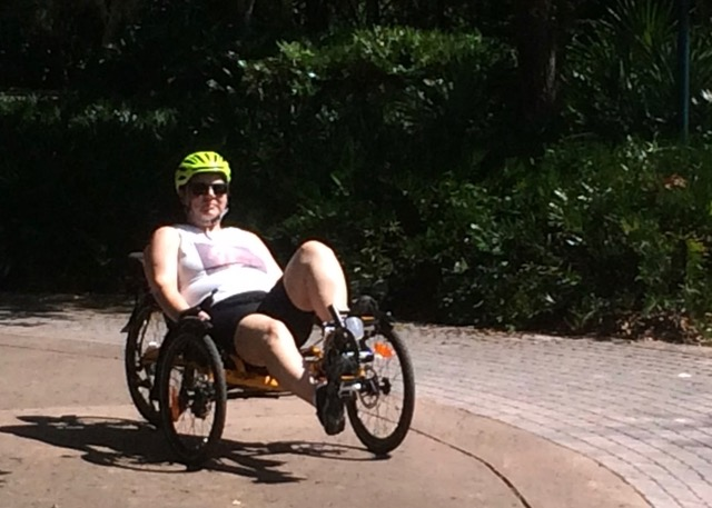 Marianne riding her Catrike three-wheel recumbent trike, Seminole Wekiva Trail, April 2014.jpeg