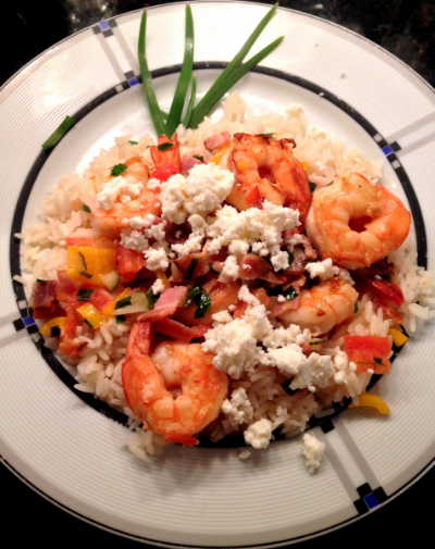 Shrimp Scampi over rice topped with queso blanco.
