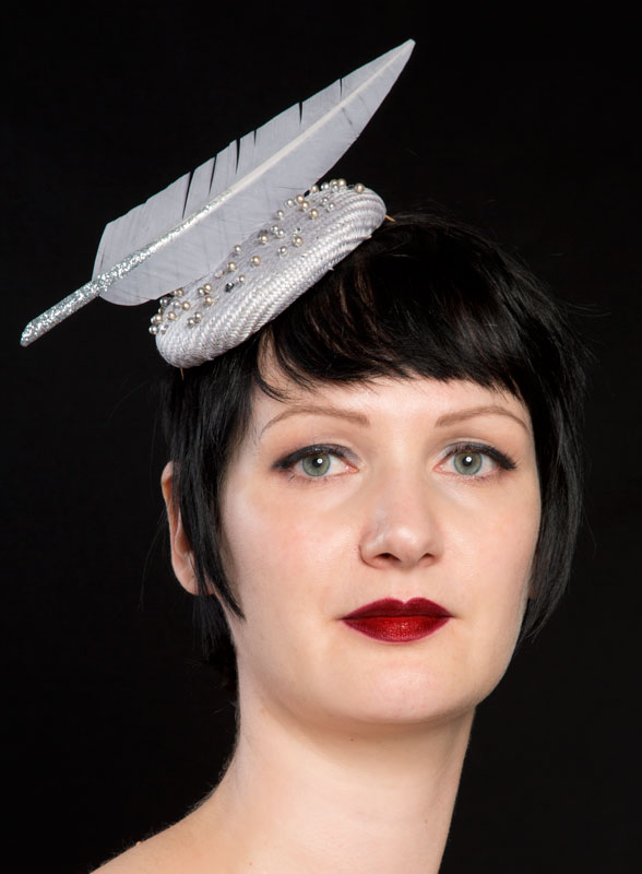 5ce57d7b770 Silver straw hat with glittery feather