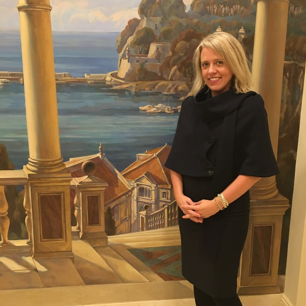 Cathleen Kelley of Monte Carlo SBM-Hotels, Casinos, Spa poses in front of a hand-painted mural in her New York office gracing the Prim & Wilde Spring 2016 Cape and Pencil Skirt with her innate chic and charm.