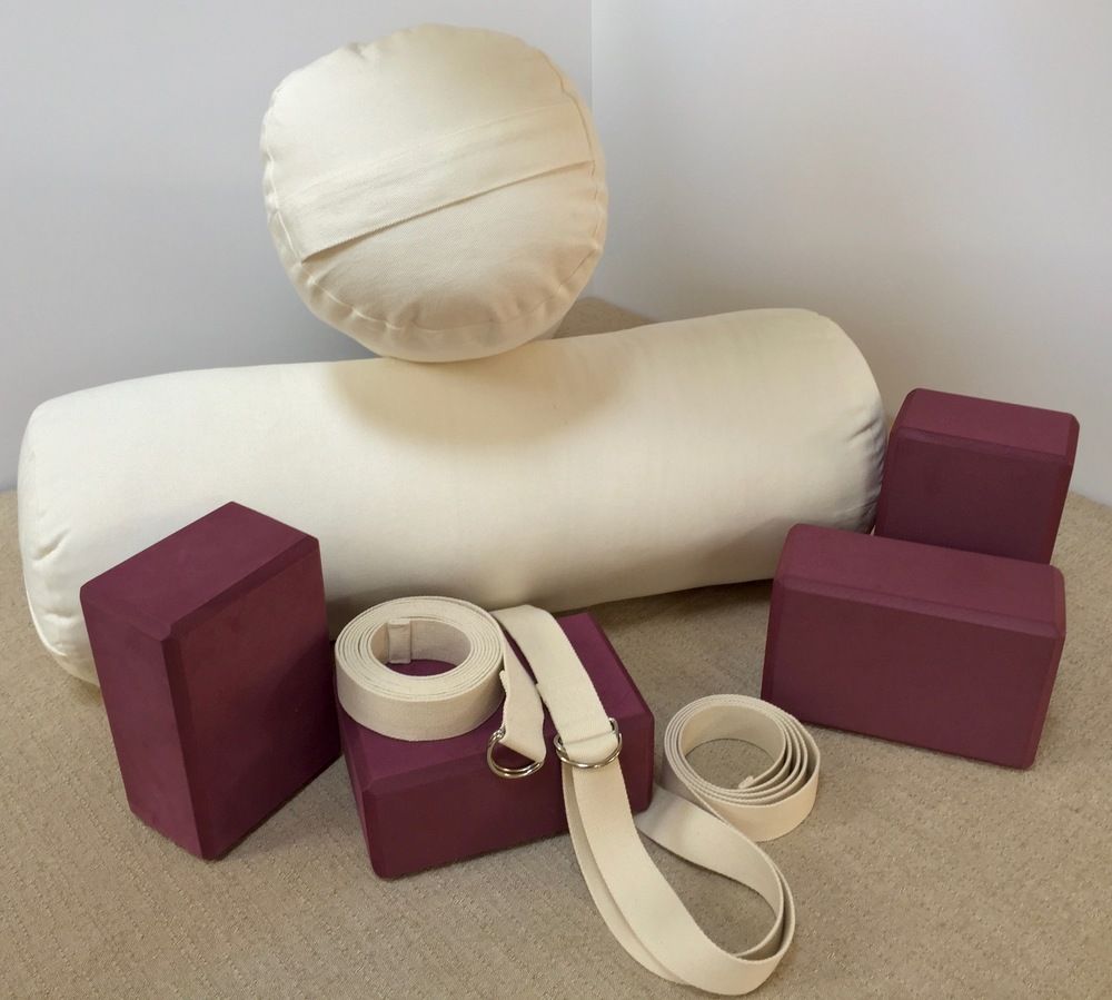 3 essential prop to have at home: 2 blocks, one 10-foot strap and a bolster.