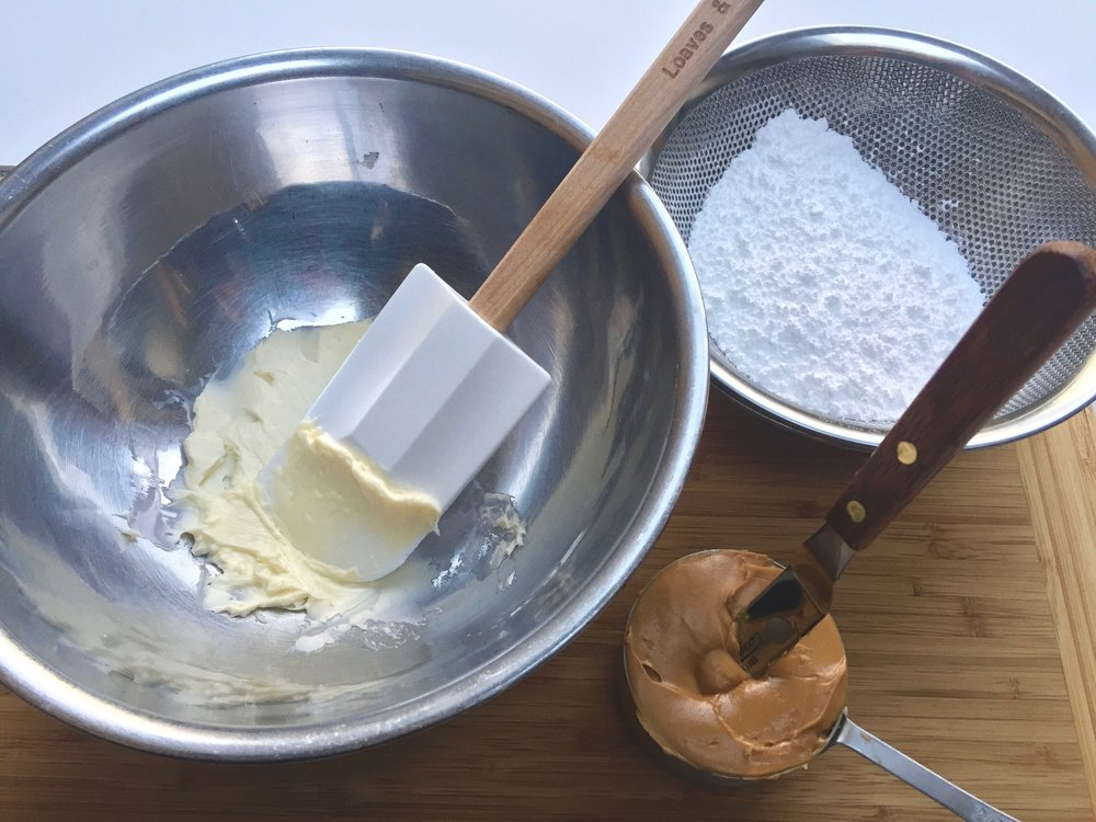 Creaming butter before adding peanut butter in 2 stages.