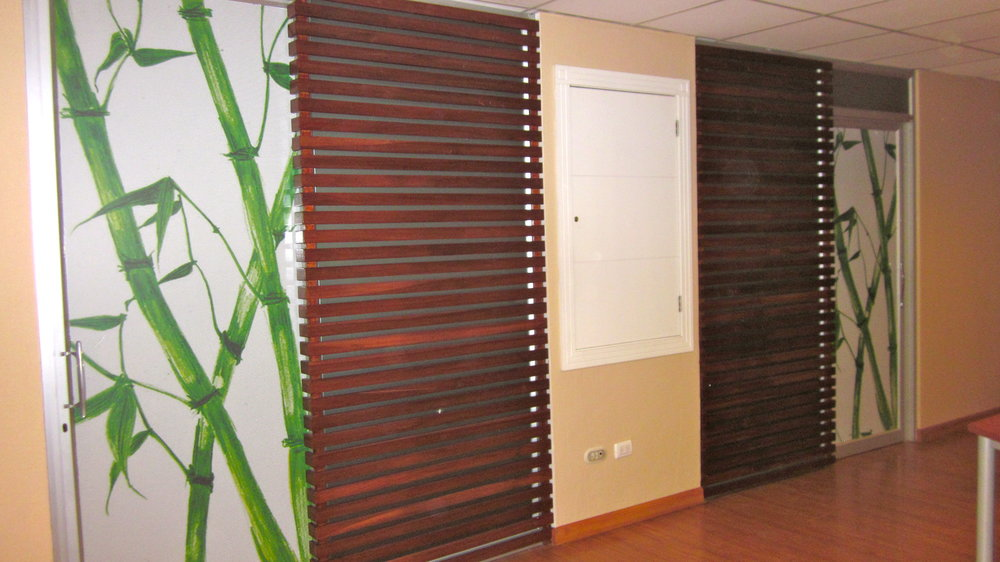 The doors of both treatment rooms were decorated with a beautiful bamboo and mahogany motif.