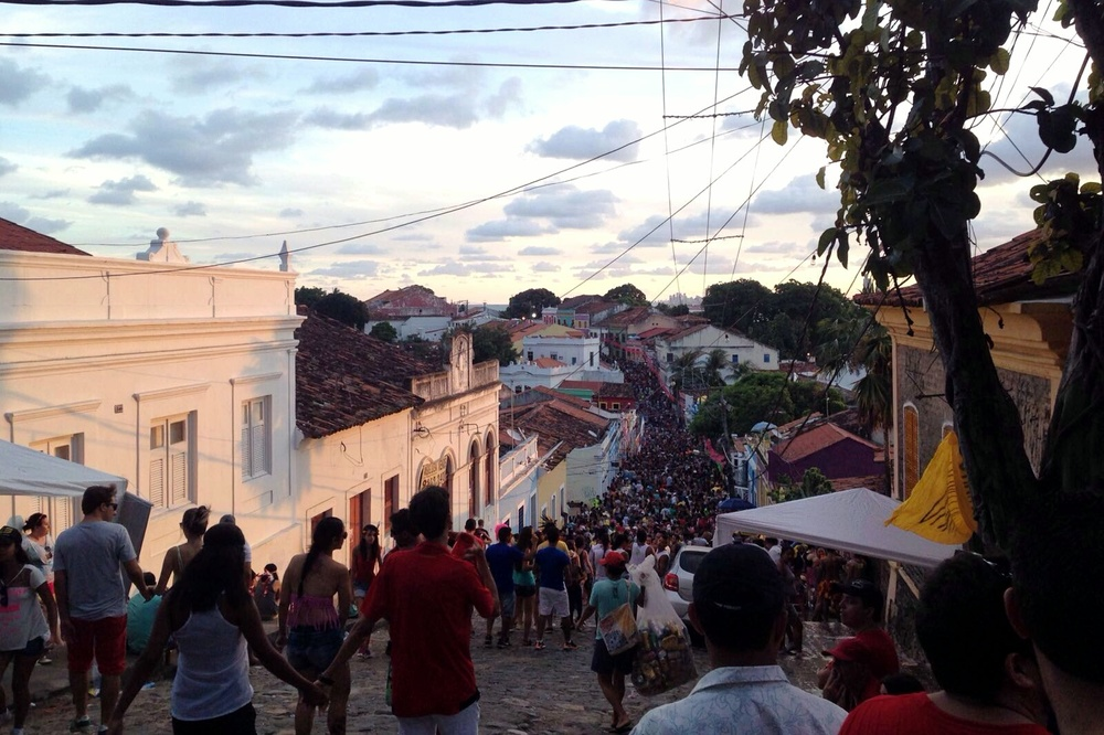 Olinda during sun set. What the picture can't capture is the smell of grilled meat, fried maniok and beer. And the sounds of blocos playing Frevo, the music originating in the state of Recife.