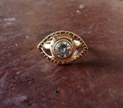18K gold eye engagement ring with 2.5 carat bezel set diamond