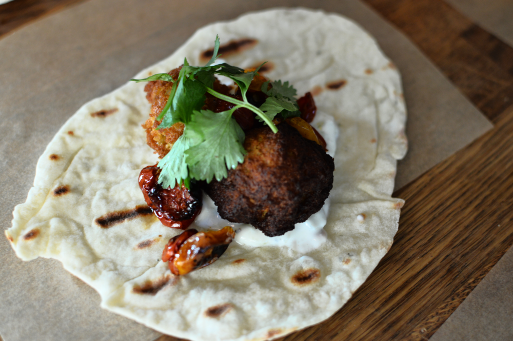 Mouthwatering thyme flat-bread w/caramelized onion & creme fraiche falafel, slow roasted cherry tomatoes, & tzatziki - A M A Z I N G