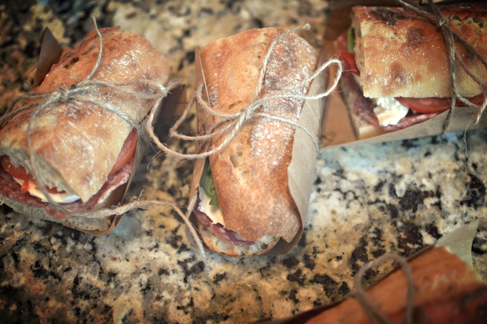 Wrapped antipasti sandwiches.