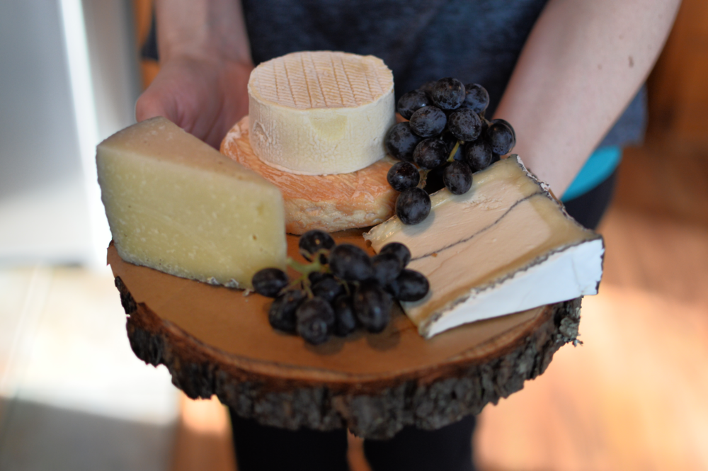 Cut wood slices (made by the groom!) make perfect cheese boards!