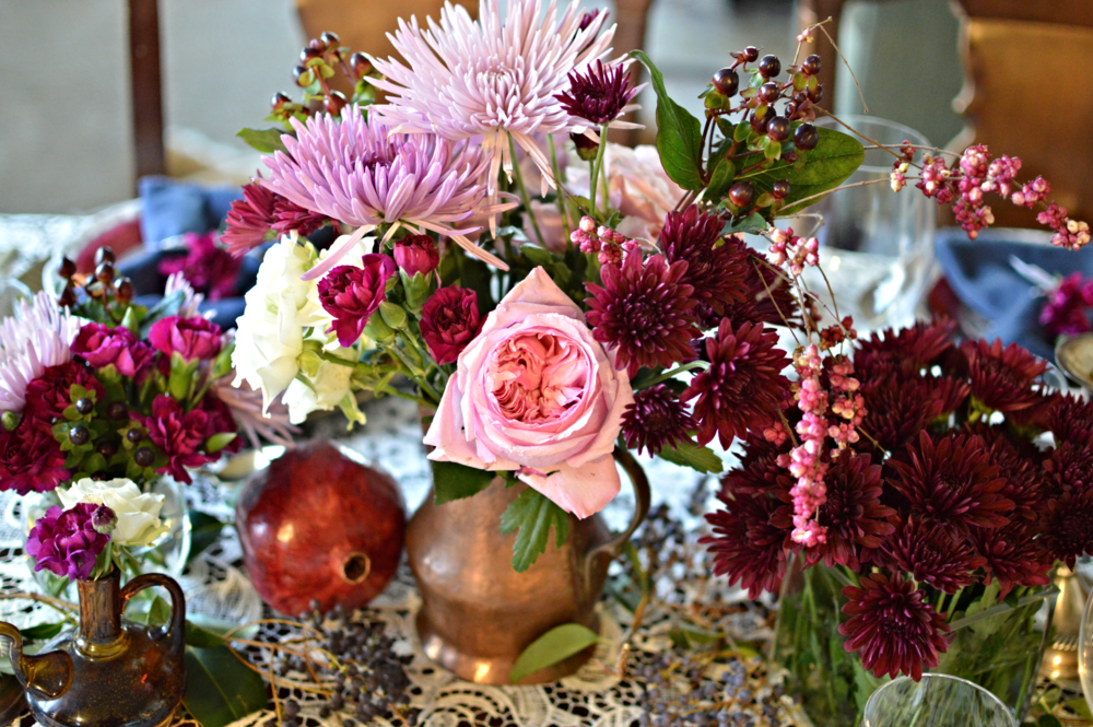 Beautiful flowers with vintage vases and pomegranates