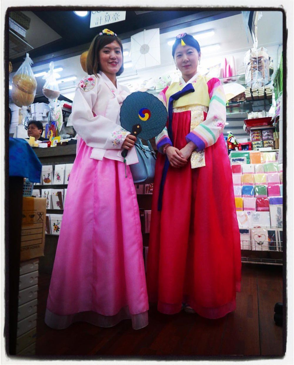 "Two Chinese tourists ""perform"" Korean Tradition in the ultimate arena of Authenticity, the souvenir shop."