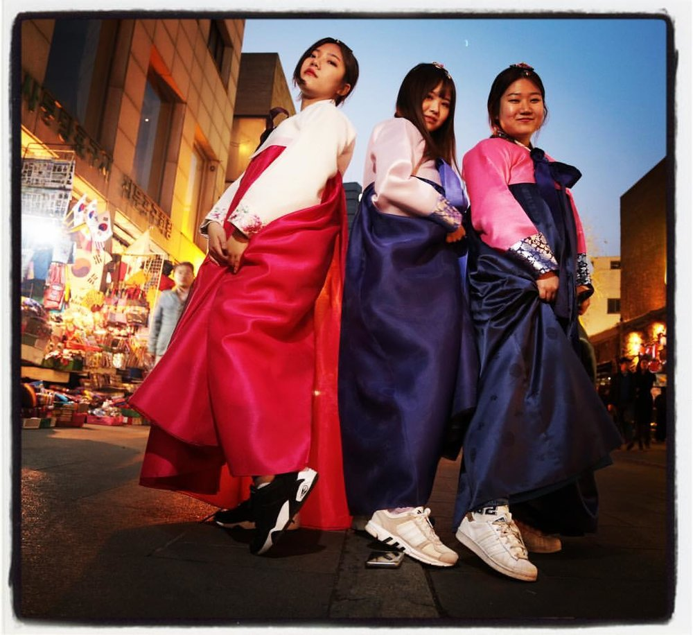 "Three Korean nationals wear the (now trendy)  hanbok  in Insadong, Seoul, which is a prime ""arena of the authentic"" in Korea, where the  hanbok  has long been a semiotic marker for Korean Tradition. In a Society of the Spectacle, even the Traditional has become just another referent in a sea of symbols that have become equivocated into meaninglessness, and just another element to be recycled into the relentless, all-consuming maw of the Trend Machine."