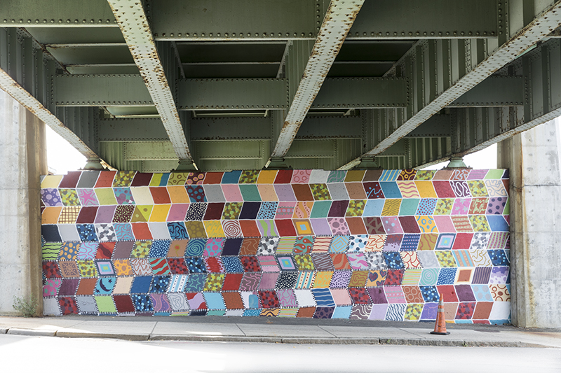 The Tobin Art Wall is located at Third Street and Everett Ave under the Tobin Bridge in Chelsea, Ma 02150