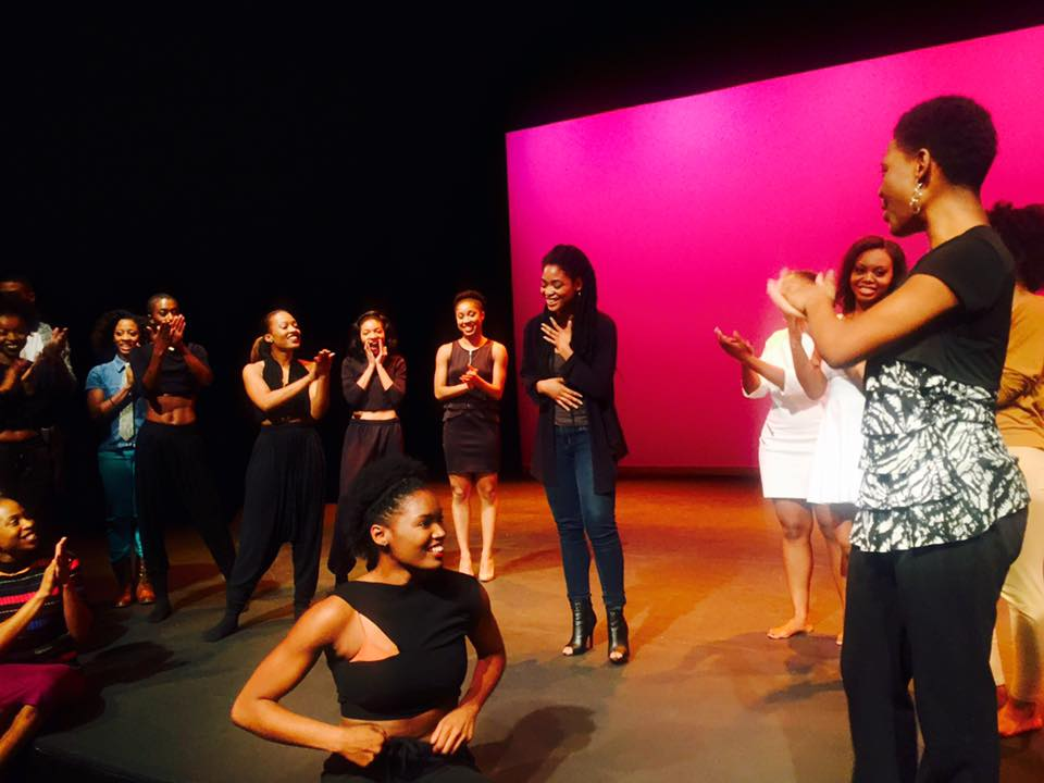 Emerging choreographer, Bre Seals, is greeted by standing ovation from dancers and attendees at end of  showcase.