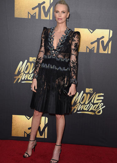 Charlize Theron looks stunning in her Alexander McQueen.