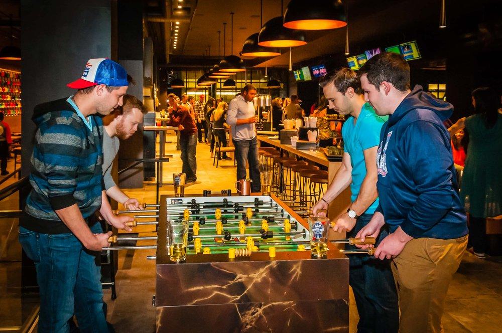 games-foosball-action-four-people.jpg