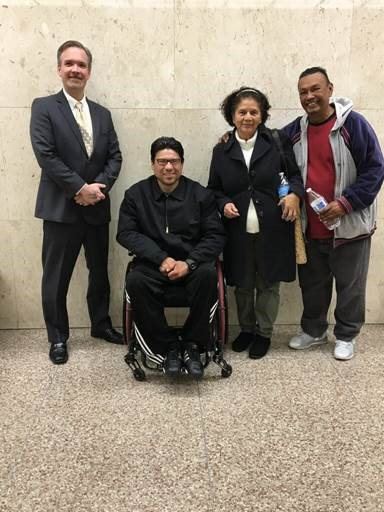 Nelson Valle, pictured with his family and UPI's Staff Attorney Sean Garcia-Leys, is excited to have been removed from California's gang database.