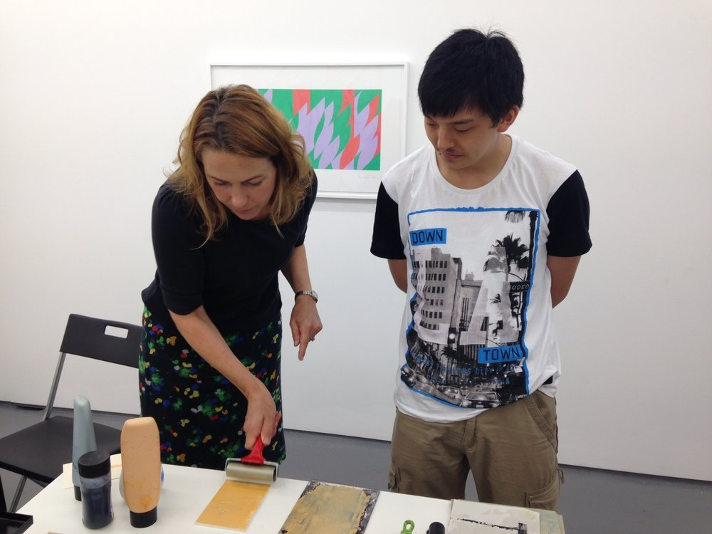 Kate giving a printmaking demonstration at an event in FOLD gallery