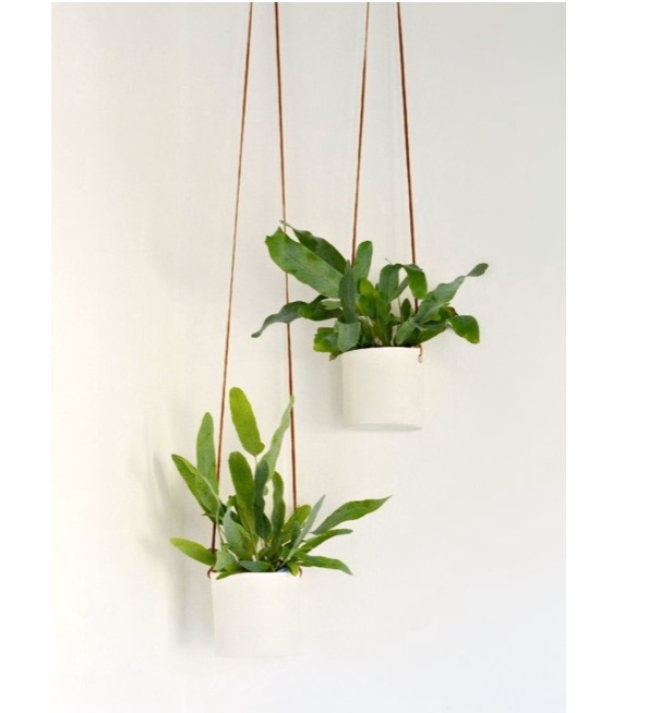 7. Leave pot to dry. Once completely dry, smooth rough edges with sandpaper. Loop the leather cord through the holes to finish. Measure to desired height. Plant your favourite houseplants and voila!