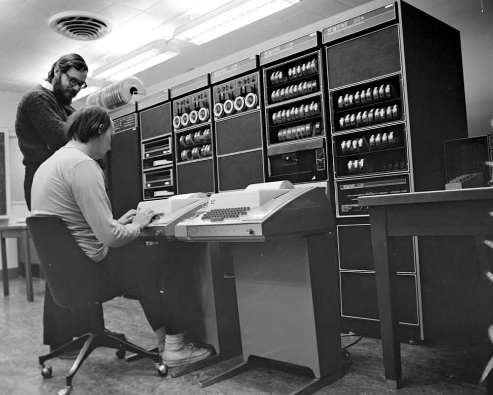 Ken Thompson (sitting)-&-Dennis Ritchie at PDP-11 courtesy of Peter Hamer
