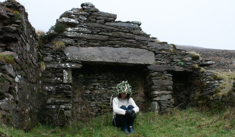 ceremony in stone cottage with mask.