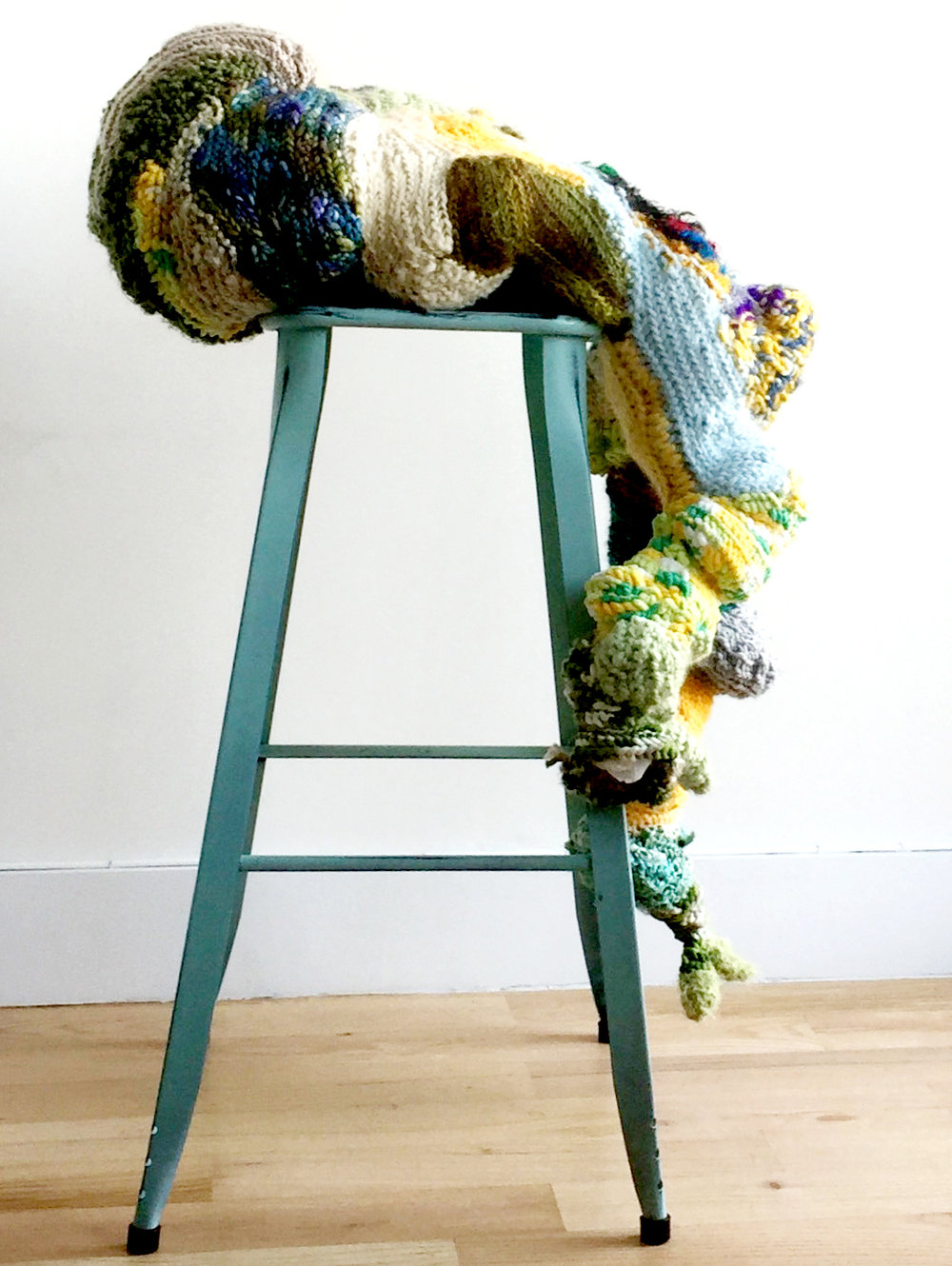 a seat at the table, 39 x 26 x 21 inches  Yarn, upcycled grocery bags (stuffing), stool.    Continuing to abstract the feminine body as ceremonial object/fertility sculpture, this full figure has taken her seat at the table.  See more here.