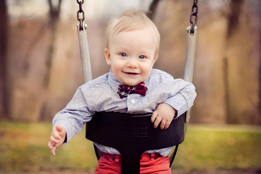 baby boy in swing smiling | shaker heights photography
