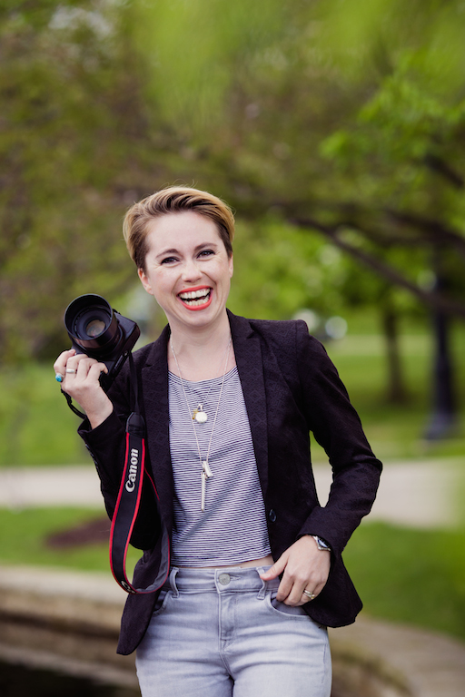 woman with camera in hand smiling | cleveland OH portrait photography