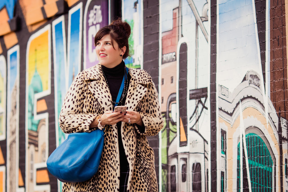 woman walking by cleveland mural | ohio city portrait photographer