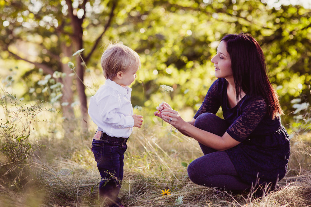 toddler son giving mom a flower | cleveland lifestyle motherhood photography