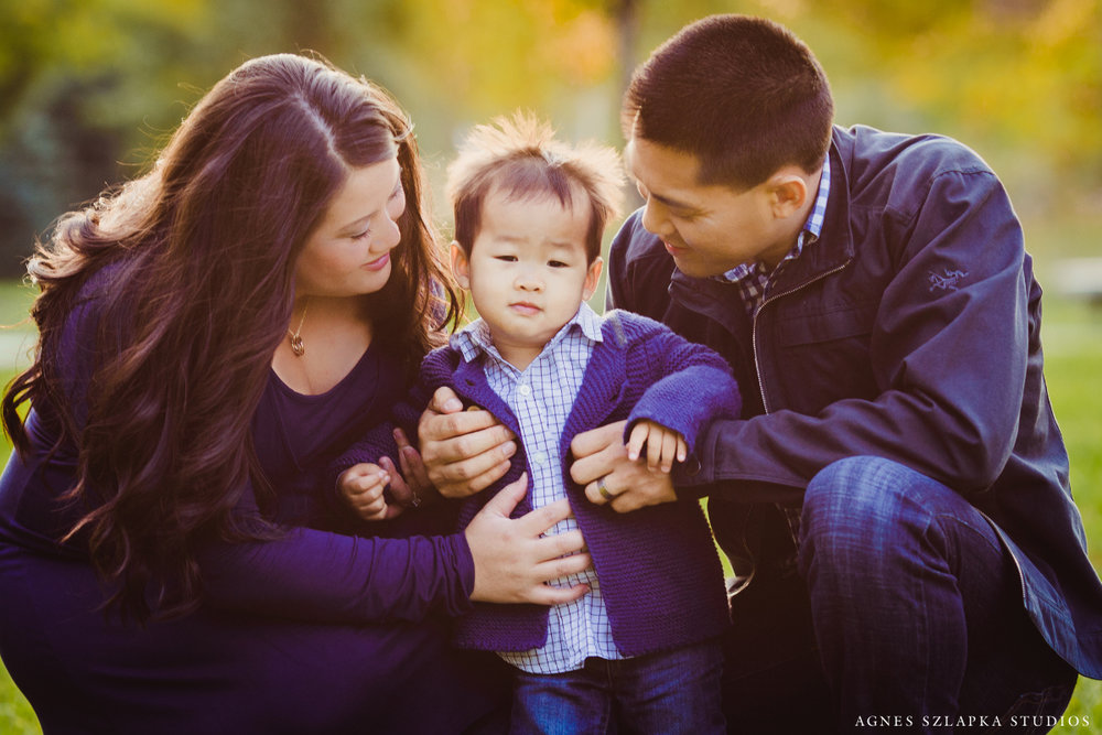 parents holding toddler boy | cleveland OH family photographer