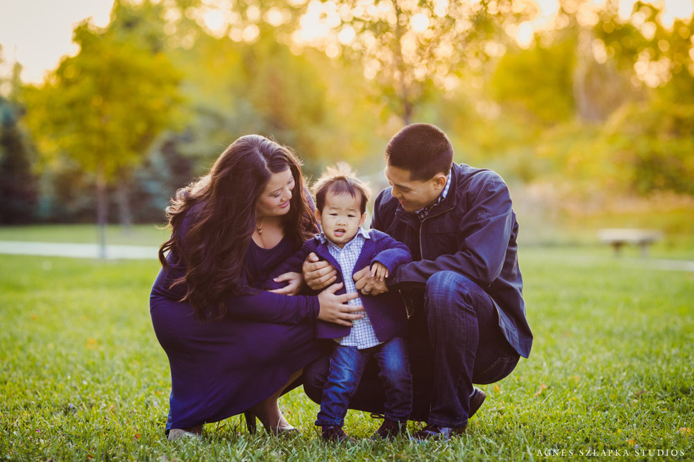 parents holding toddler boy dressed in navy colors | cleveland OH family photography