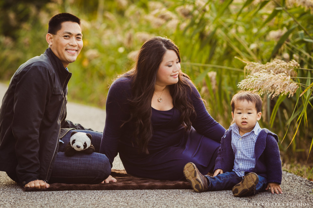 family of three sitting on path | cleveland kids portraits
