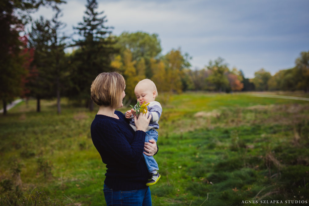 mom and baby son in park playing | cleveland ohio lifestyle family photography