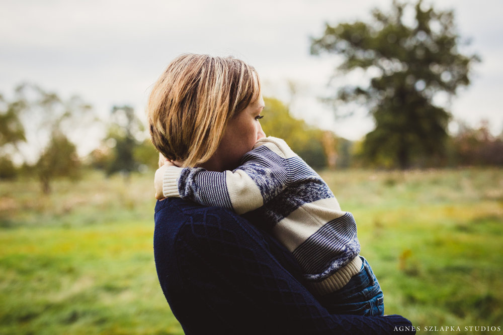 mom holding younger brother in arms | cleveland ohio lifestyle photographer
