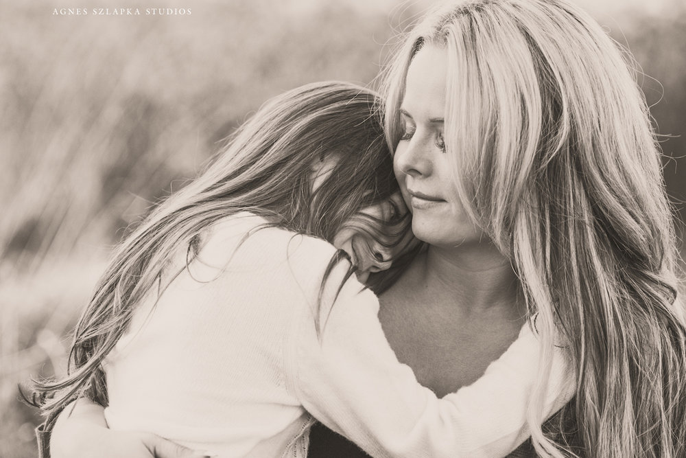 mother hugging daughter close and smiling | cleveland, ohio lifestyle photographer