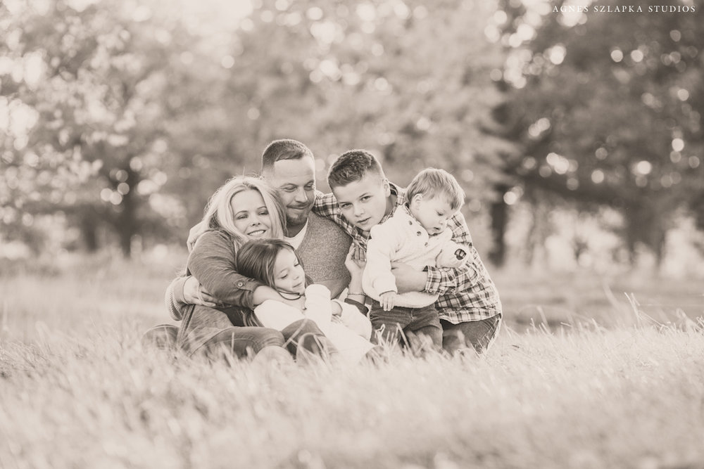family of five cuddles together in park | cleveland, ohio lifestyle photographer