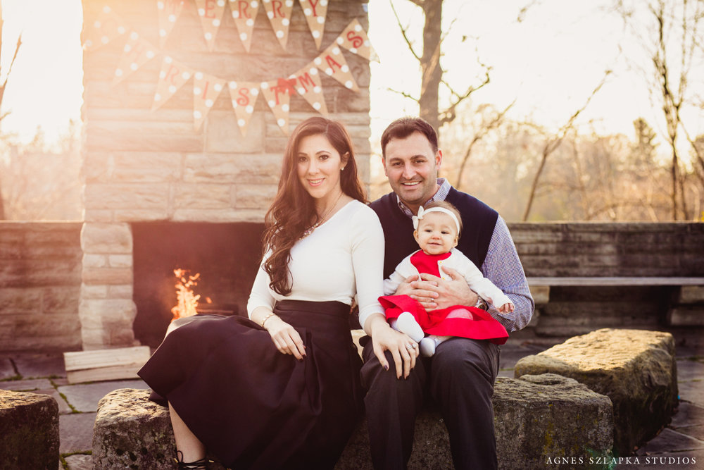 family holiday photo by outdoor fireplace | cleveland, ohio lifestyle photographer