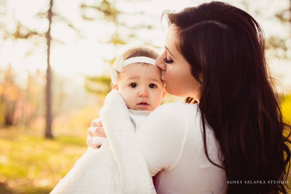 mommy kissing baby girl in red dress | cleveland, ohio family photographer