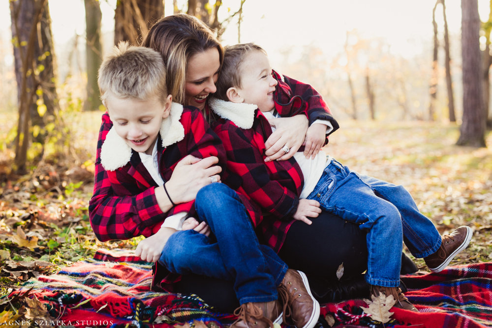 mom with her two children laughing | cleveland, ohio family photos