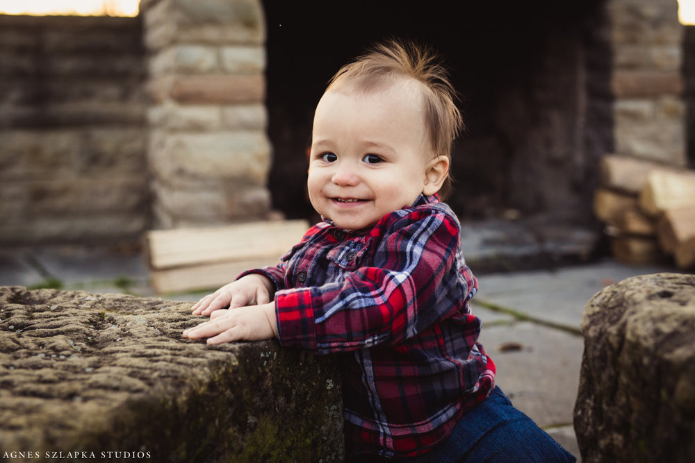 one year old baby boy standing up by rock | cleveland, ohio family photos