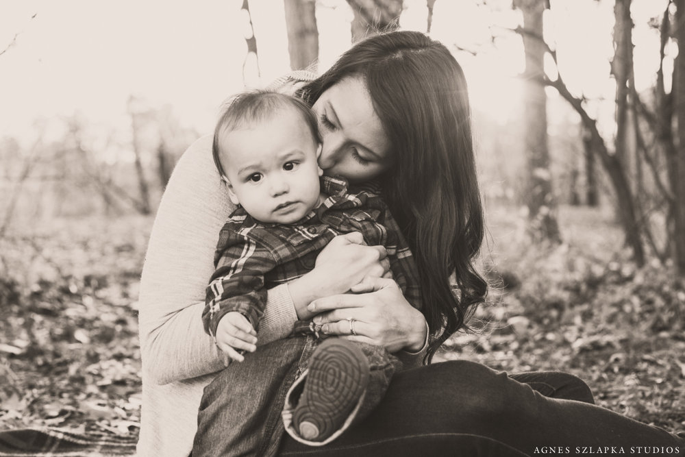 mother with baby boy son cuddling on blanket | cleveland, ohio family photography