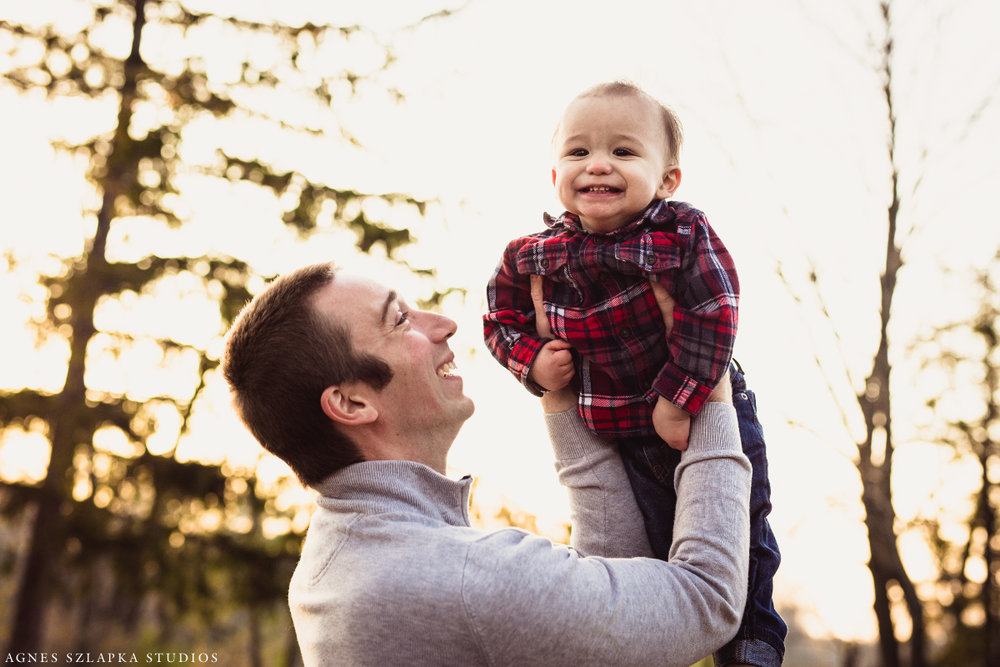dad raising baby boy up high to sky | cleveland, ohio family lifestyle photography