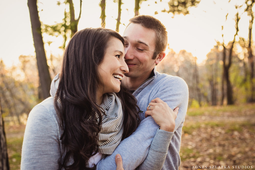 husband and wife embracing and laughing together | cleveland, ohio family portraits